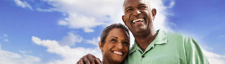 Happy mature couple under a beautiful blue sky.